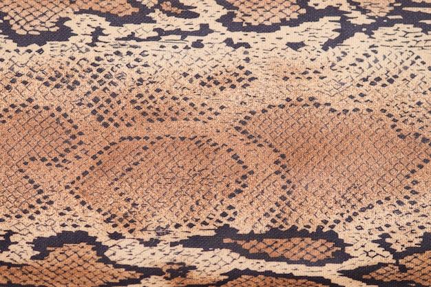 Fundo de pele de cobra, close-up, textura bege e marrom Foto Premium