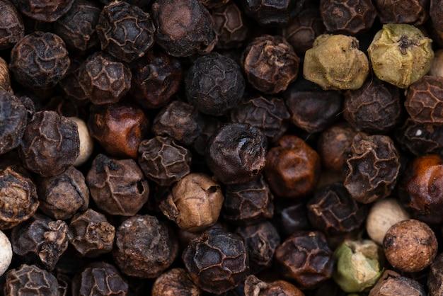 Fundo de pimenta preta em close-up Foto gratuita
