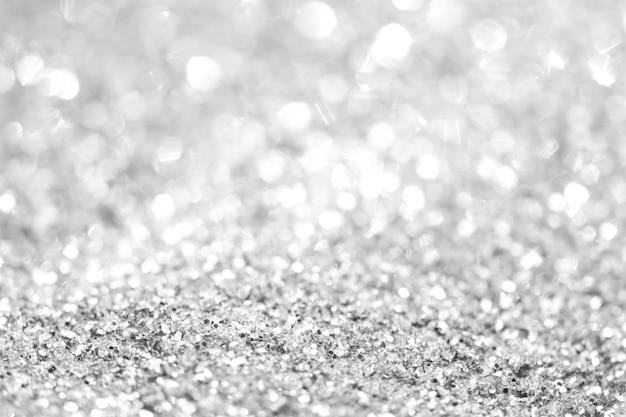 Fundo de prata de luzes abstratas desfocadas. luzes douradas do bokeh. Foto Premium