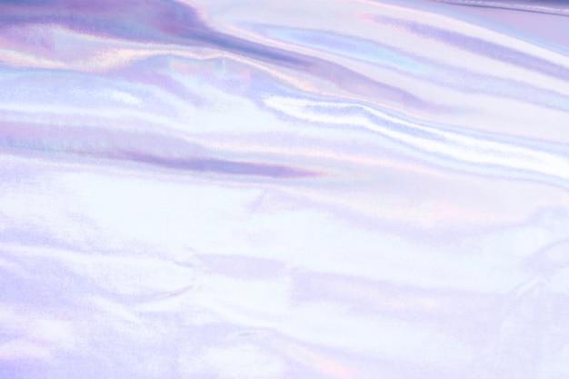 Fundo de textura de folha de sereia iridescente holográfica. cores prata na moda futurista néon Foto Premium