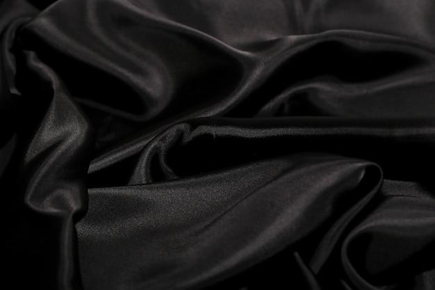 Fundo de textura de tecido de seda preto Foto gratuita