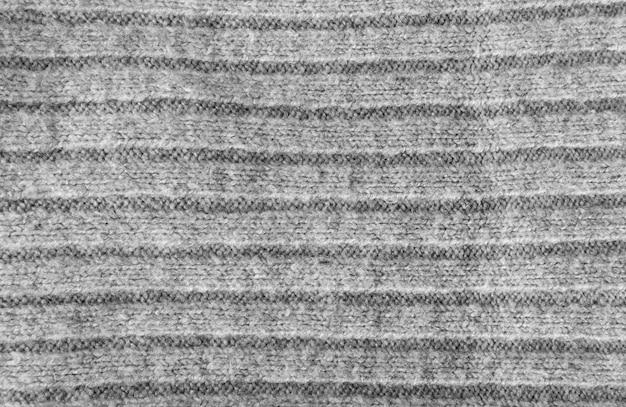 Fundo de textura de tecido listrado de malha, padrão têxtil cinza Foto Premium