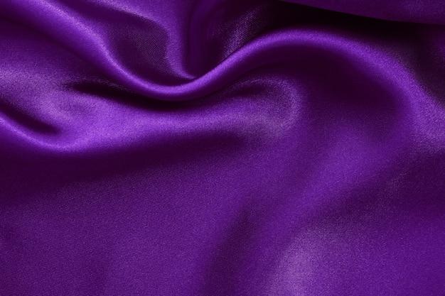 Fundo de textura de tecido roxo escuro, seda ou linho amassado. Foto Premium