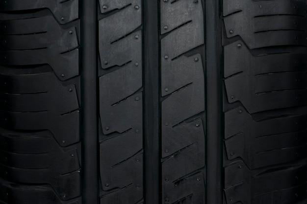 Fundo do pneu de carro, fundo do close up da textura do pneu. Foto Premium