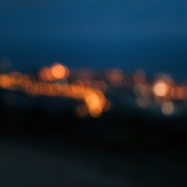 Fundo festivo de luzes cintilantes com textura Foto gratuita