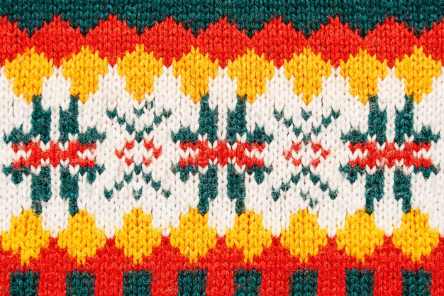 Fundo heterogêneo da textura da camisola do natal. textura de malha colorida Foto Premium
