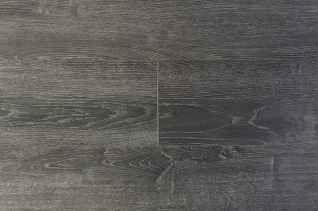Fundo laminado. placas de madeira estratificadas e parquet para o piso em design de interiores. textura e padrão de madeira natural Foto Premium