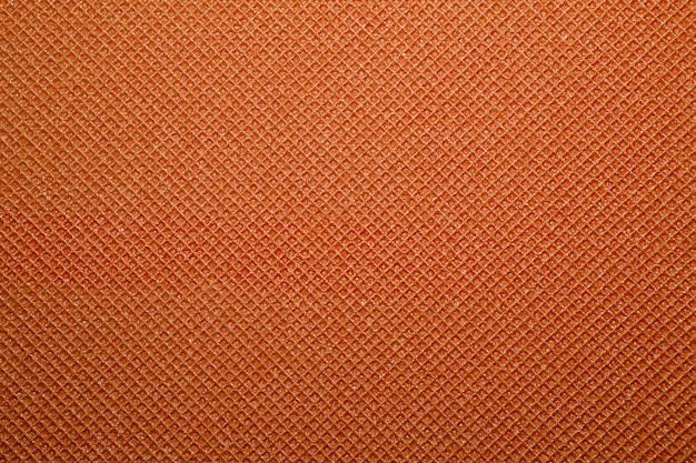 Fundo laranja da textura do tapete de ioga. fundo do tapete de acampamento Foto Premium