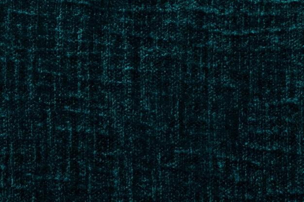 Fundo macio verde escuro de pano macio e fofo. textura da matéria têxtil peludo do luxuoso, close up. Foto Premium