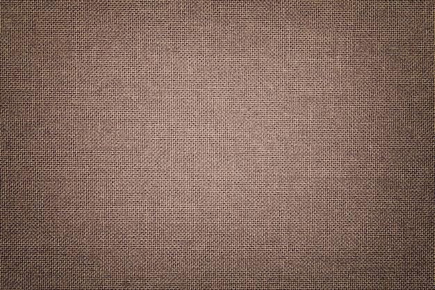 Fundo marrom de um material têxtil com padrão de vime Foto Premium