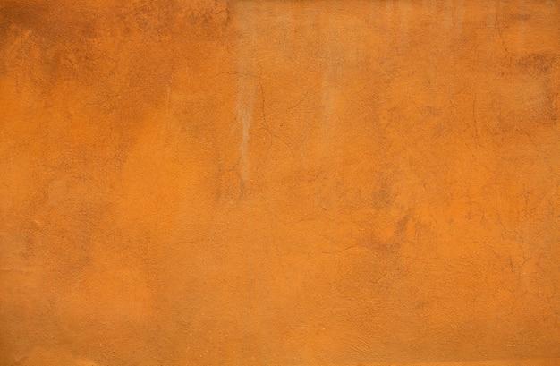 Fundo ou textura alaranjada do estuque da cor. luz brilhante parede rebocada de um edifício Foto Premium