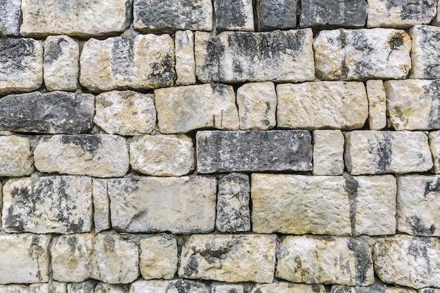 Fundo sujo velho da textura da parede de pedra cinzenta Foto Premium