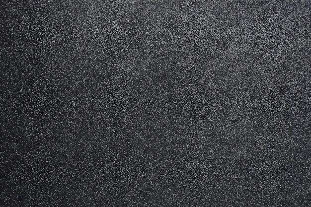 Fundo texturizado brilho preto acidentado, closeup Foto Premium