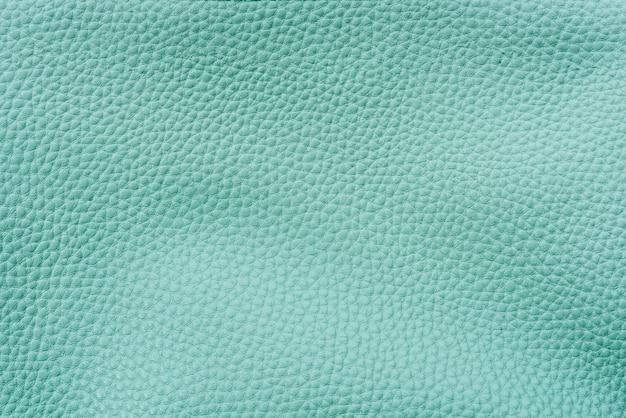 Fundo texturizado de couro teal liso Foto gratuita