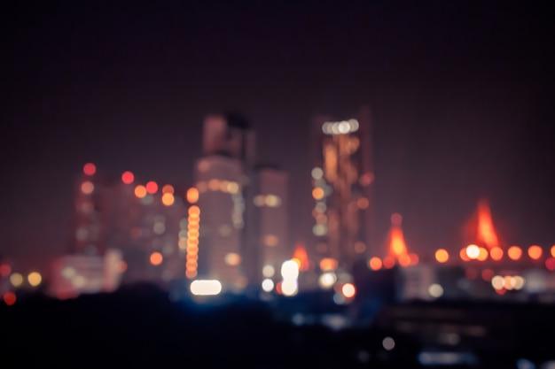 Fundo vintage bokeh com luz na cidade à noite Foto Premium