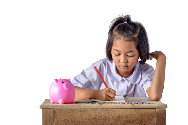 Garota asiática bonito do país faça uma nota de recibos de renda e moedas Foto Premium