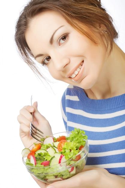 Garota comendo comida saudável Foto Premium