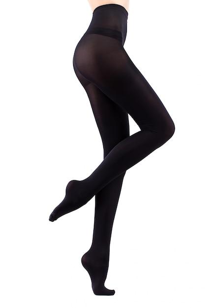 Garota de meia-calça preta. isolado no branco Foto Premium