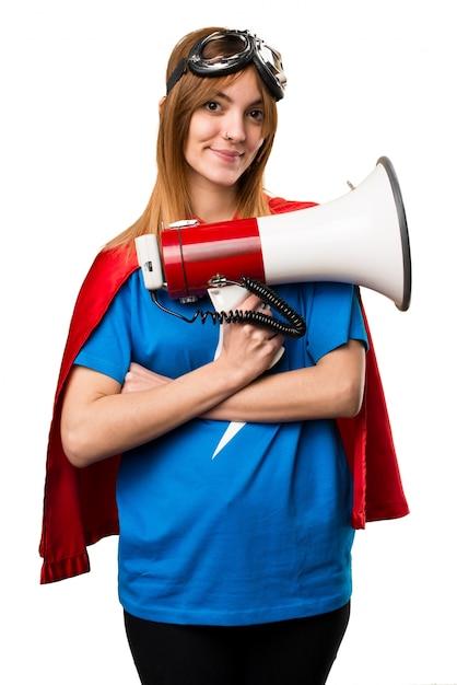 Garota muito super-herói gritando pelo megafone Foto Premium