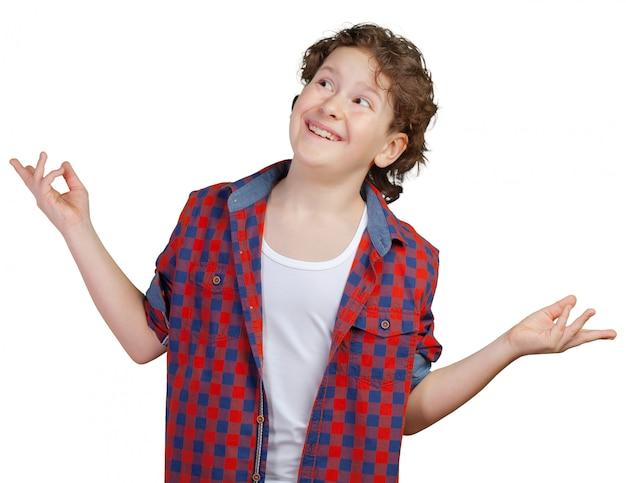 Garoto adolescente encolhe os ombros com perda Foto Premium