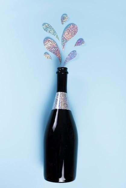 Garrafa de champanhe com salpicos de glitter Foto gratuita