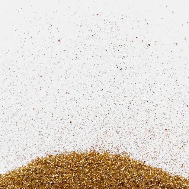 Glitter de luxo ouro sobre fundo branco Foto gratuita