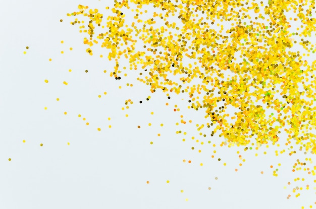 Glitter dourado abstrato com fundo de espaço de cópia Foto gratuita