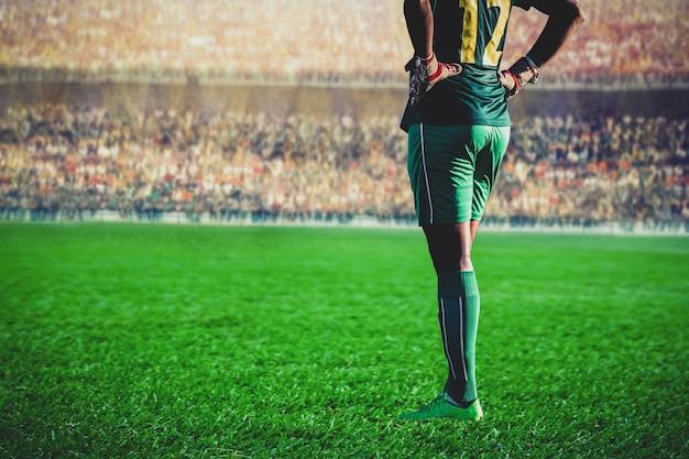Goleiro de futebol de futebol em pé no estádio Foto Premium