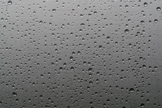 Gotas de chuva em vidros de janela Foto Premium