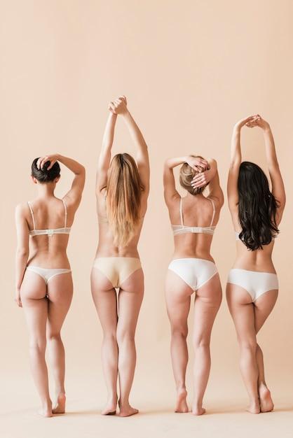 Grupo, de, confiante, mulheres, posar, em, undergarment Foto gratuita