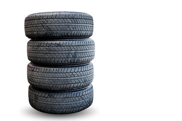 Grupo do close up de pneus no fundo branco. Foto Premium