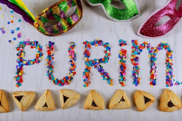 Hamantaschen cookies e carnaval máscara purim celebração Foto Premium