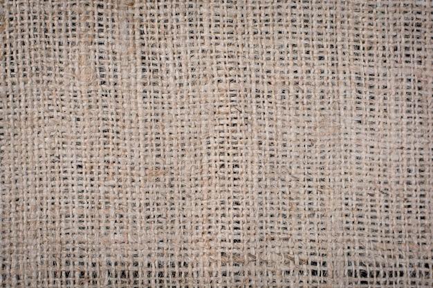 Hessian sackcloth tecido textura de fundo em tom de cor marrom creme bege claro Foto Premium