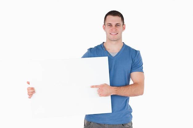 Homem, apontar, em branco, painel Foto Premium
