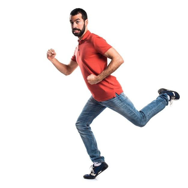 Homem bonito correndo rápido Foto gratuita