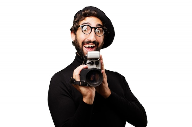 Homem com a boca aberta com uma câmera antiga na mão Foto gratuita