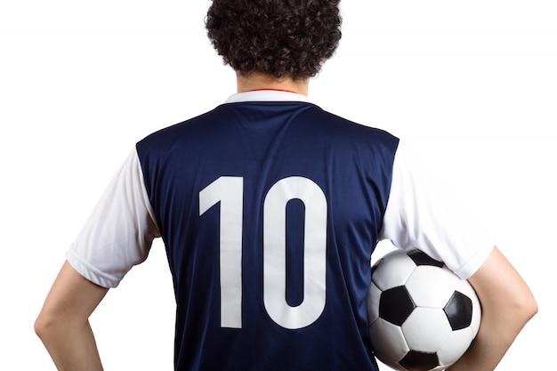 Homem com bola de futebol. Foto Premium