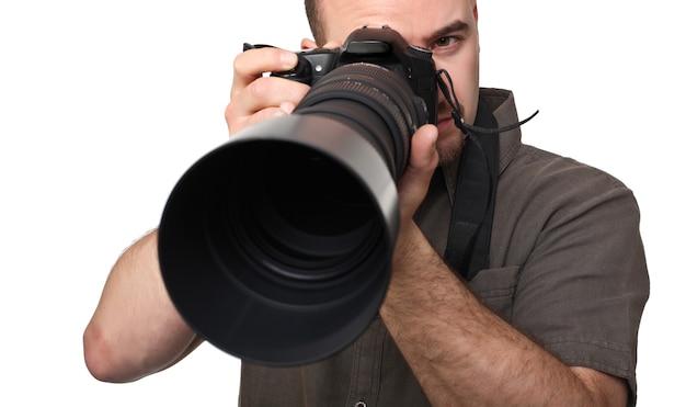 Homem com lente de câmera grande em branco Foto Premium