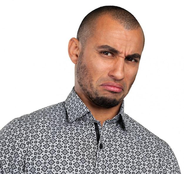 Homem com uma expressão deprimida Foto Premium