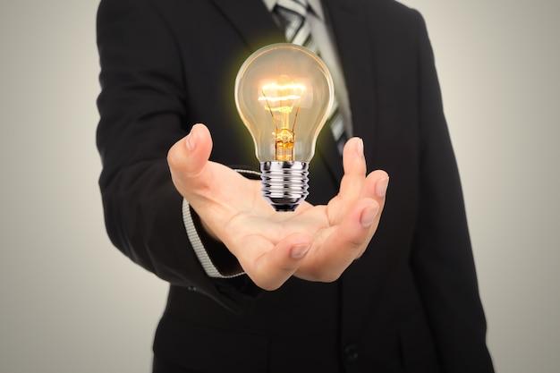 Resultado de imagem para uma lampada com uma mao em baixo