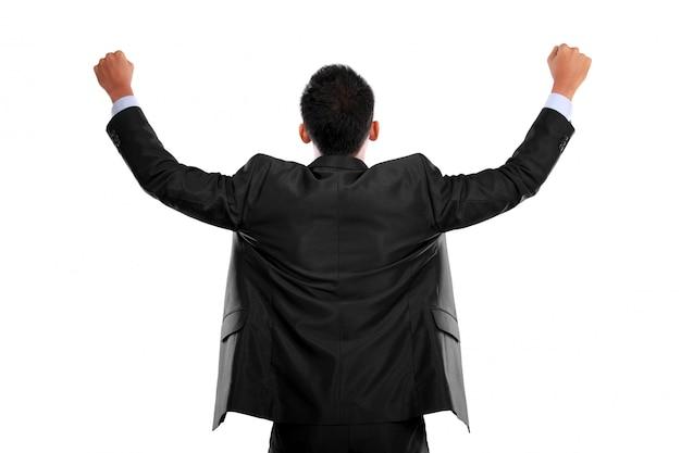 Homem de negócios com os braços levantados em sucesso Foto Premium
