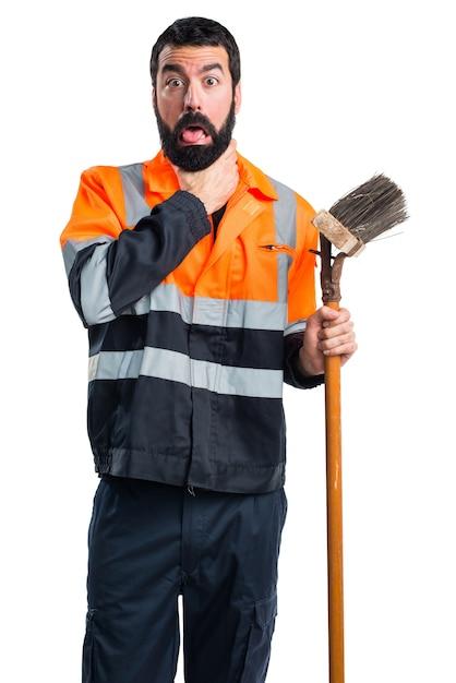 Homem do lixo se afogando Foto gratuita