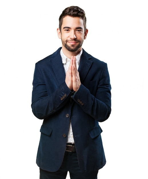 Homem elegante orando Foto gratuita