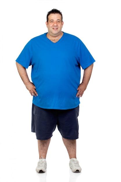 Homem gordo feliz isolado no fundo branco Foto Premium