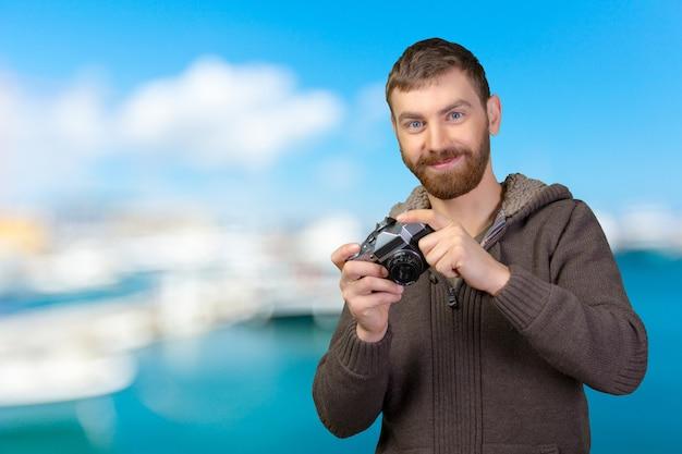 Homem jovem, com, câmera Foto Premium