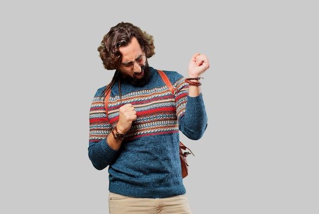 Homem jovem hippie dançando Foto Premium