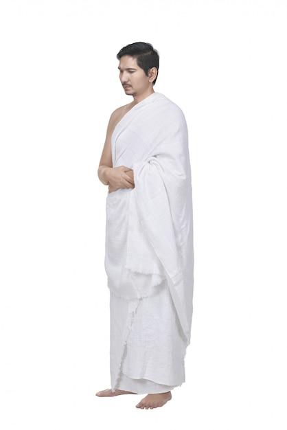 Homem muçulmano asiático religioso com vestido de hajj Foto Premium