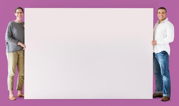 Homem mulher, segurando, em branco, tábua Foto Premium