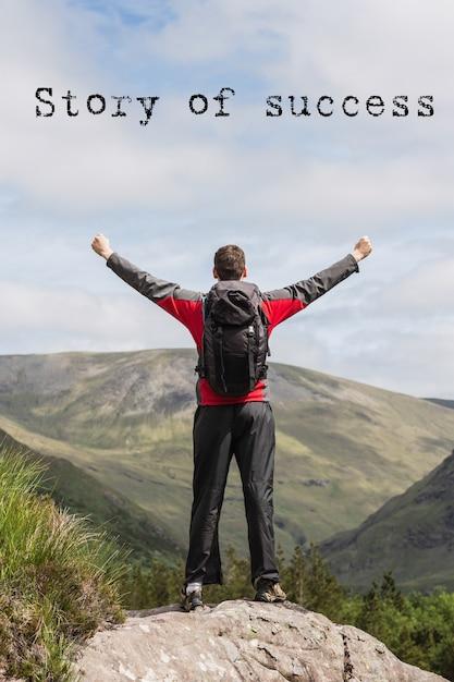 Homem na parte superior de uma montanha com a frase inspiradora Foto gratuita