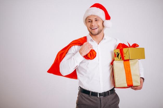 Homem negócio, em, chapéu santa, segurando, presente natal, isolado Foto gratuita